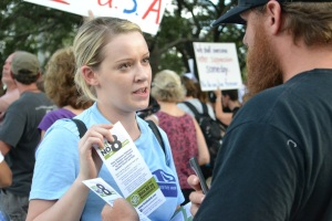 ACLU of Florida Field Coordinator Nikki Fisher distributing material at the Rally Against Voter Suppression in Ybor City
